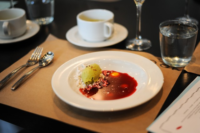 Chilled hibiscus consommé with avocado, white chocolate and passionfruit.