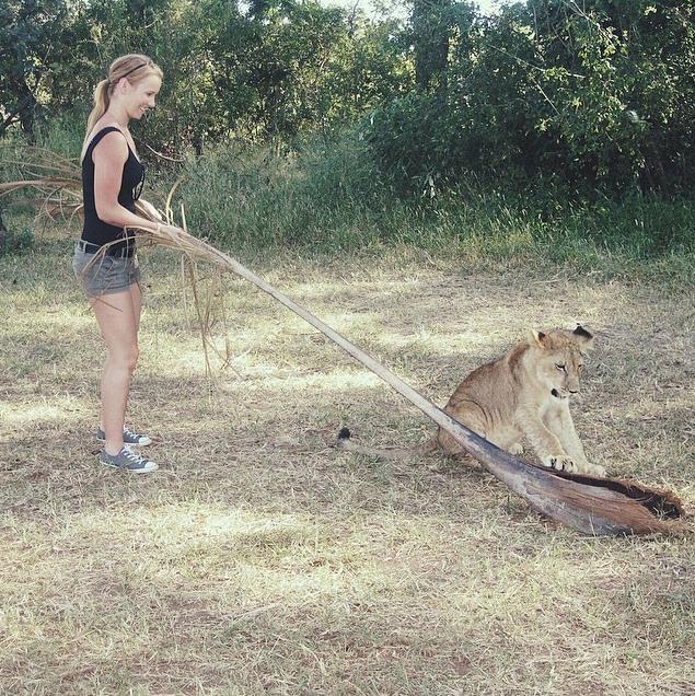 Nicole and a lion cub