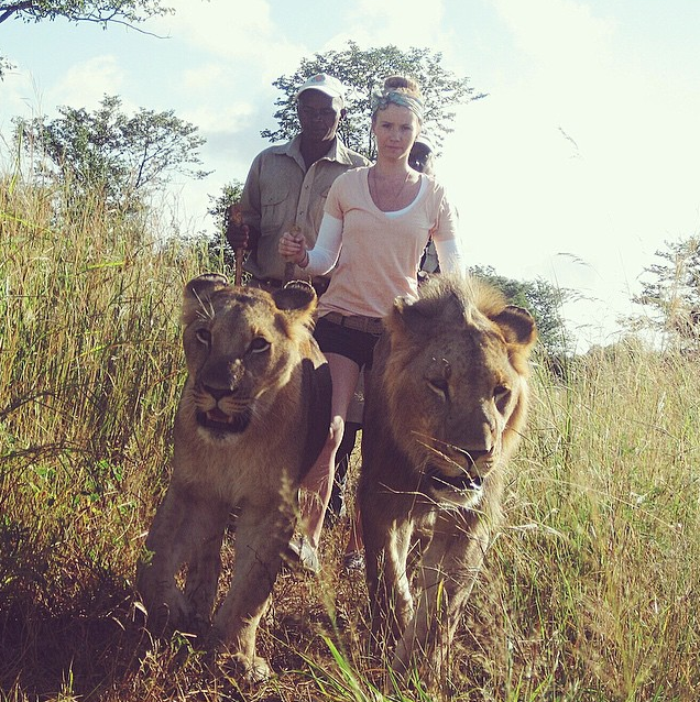 Nicole walks with lions